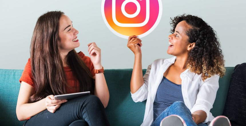 Young women showing an Instagram icon